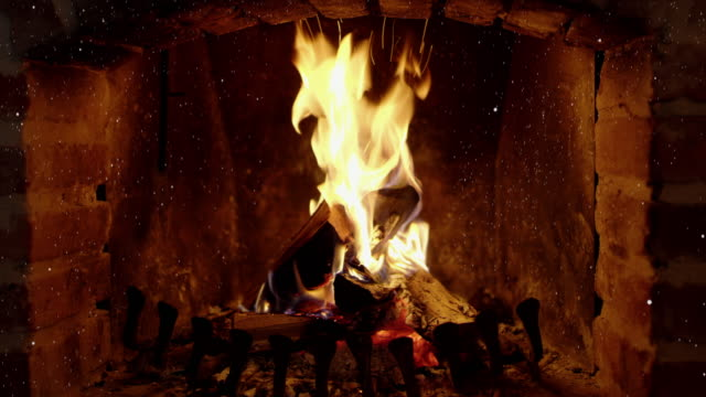 4K Tranquil, crackling fire and ash in brick fireplace, real time with audio 4K Tranquil, crackling fire and ash in brick fireplace with audio. MS, lockdown, real time. brick stock videos & royalty-free footage