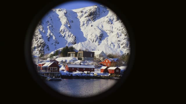 Tranquil scene of fishing town harbor  on Lofoten islands in winter