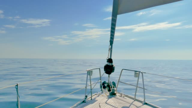 tranquil scene of sailboat bow while sailing in calm sea in the atlantic ocean. view of bow and rigs on board a sailboat - oceano atlantico video stock e b–roll