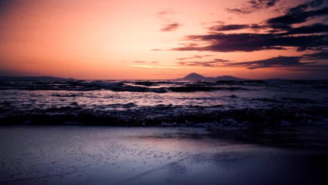 tranquil sea at sunset slow motion - пелопоннес стоковые видео и кадры b-roll