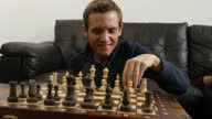 istock Trans autistic cheerful male preparing a chess board to play 1286218937