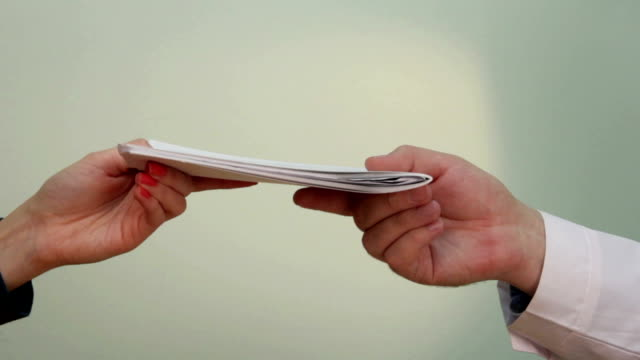 Transfer documents from hand to hand and shaking hands video