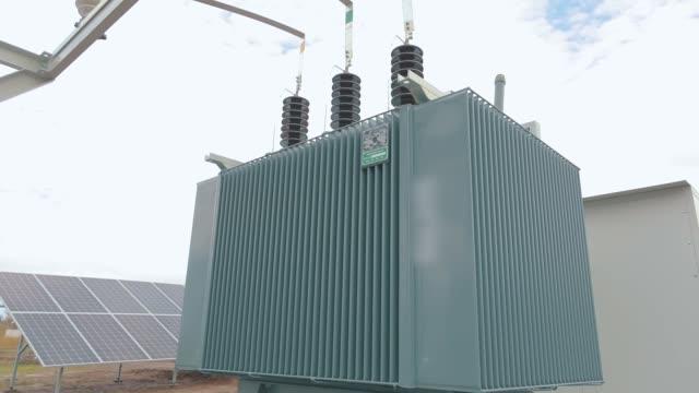 transformer at a power plant, transformer at a solar power station - sottostazione elettrica video stock e b–roll
