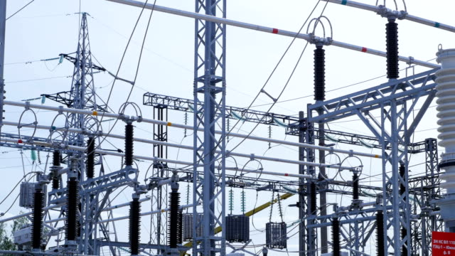 transforming substation for distributing electrical energy - sottostazione elettrica video stock e b–roll