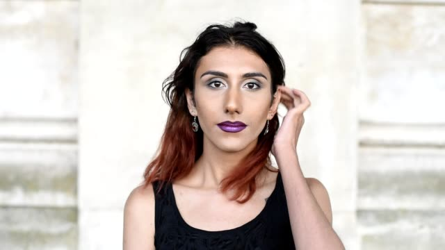 Transgender female looking to camera Attractive transgender female looking to camera portrait transgender stock videos & royalty-free footage