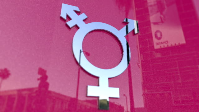 Transgender Symbol On A Pink Metallic Background video
