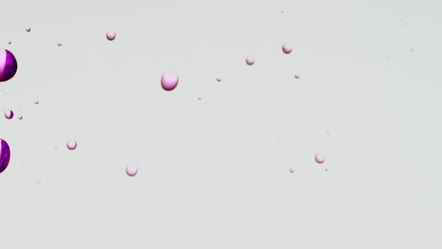 transparent cosmetic purple oil bubbles and shapes on white background - collagene video stock e b–roll