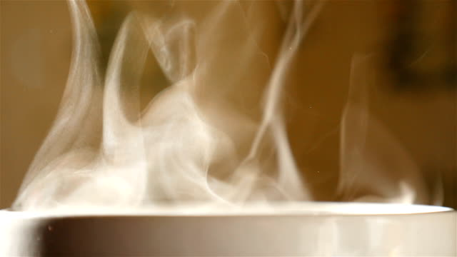 Transparent steam in a cup with tea. Slow-motion. Close-up video