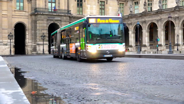 transport traffic on square place du carrousel near louvre museum toward royal palace - bus stock videos and b-roll footage