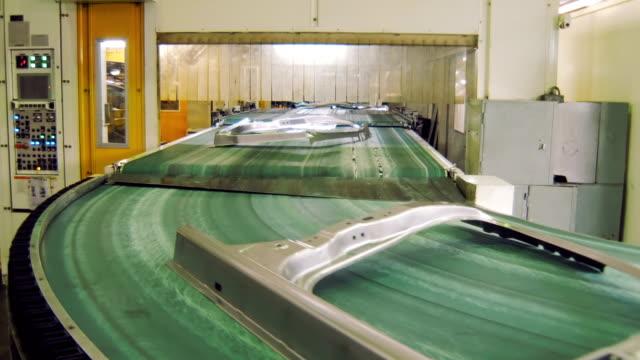 transporting tape with moving details of car body in automobile factory, making car body - część maszyny filmów i materiałów b-roll