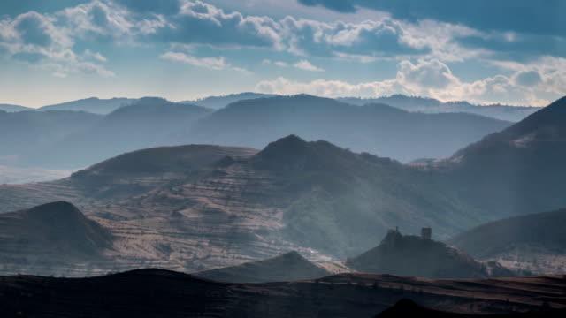 Transylvania fortress ruins sun beams time lapse video