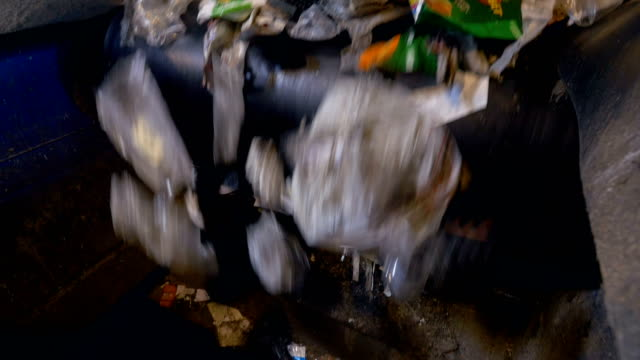 Trash conveyor system. Garbage moving on a conveyor belt. video