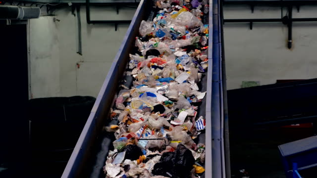 Trash conveyor working at a trash recycling plant. video