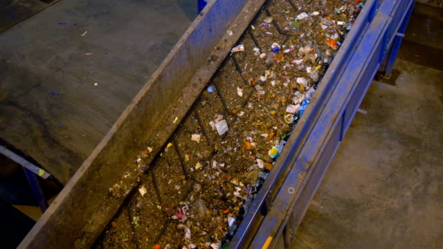 Trash, rubbish conveyor on a waste recycling plant. video