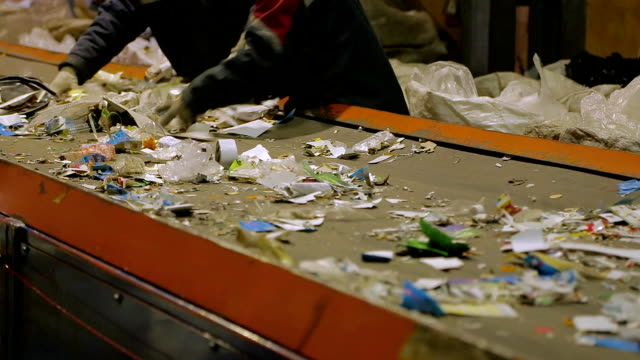 trash workers weeding through recyclables - recycling stock videos & royalty-free footage