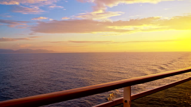 slo mo travel on the sea at sunset - cruise video stock e b–roll