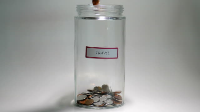 Travel savings Jar filled with coins video