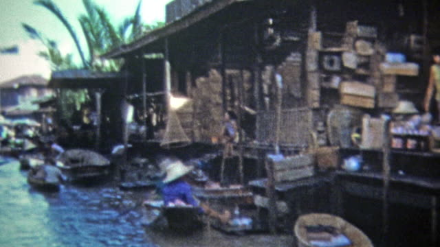 1973: Travel Southeast Asian waterways with merchant boathouses. video