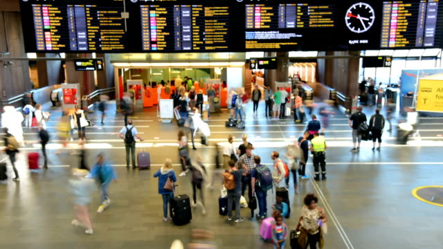 Traveler Crowd at Central Train Station during Holiday in Oslo Traveler Crowd at Central Train Station during Holiday in Oslo railroad station platform stock videos & royalty-free footage