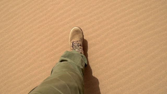 Traveler in Extreme Conditions Movement of the legs in the army gear on the sand in the desert. Slow Motion at a rate of 240 fps thirsty stock videos & royalty-free footage