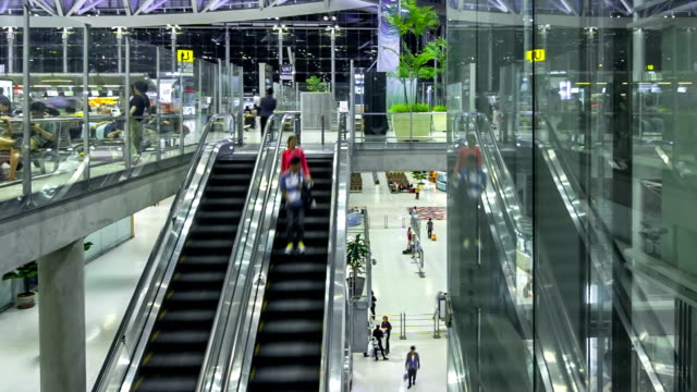 Traveler in the airport escalator,Panning shot time lapse video