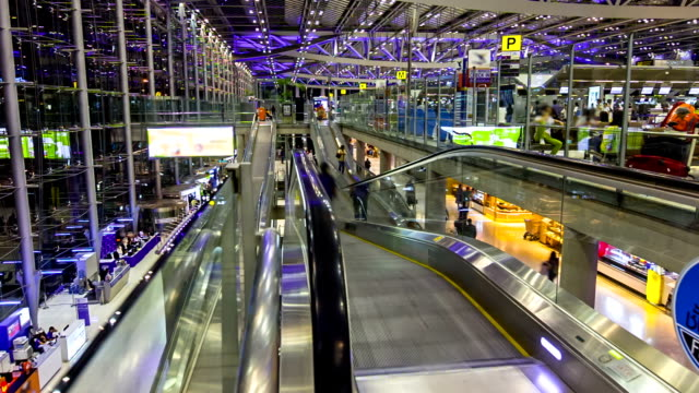 Traveler in the airport escalator,Time lapse video