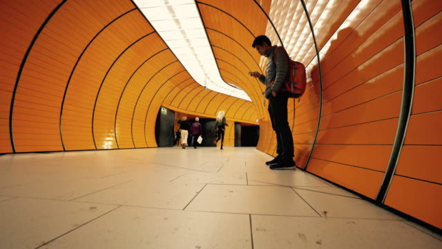 Traveler man at Munich metro Traveler man at Munich metro railroad station platform stock videos & royalty-free footage