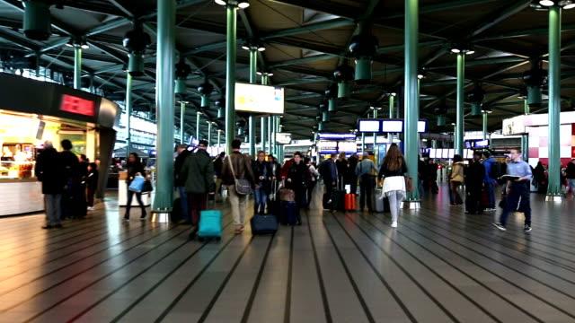 stockvideo's en b-roll-footage met hd: traveler walking at airport departure terminal amsterdam netherlands - schiphol
