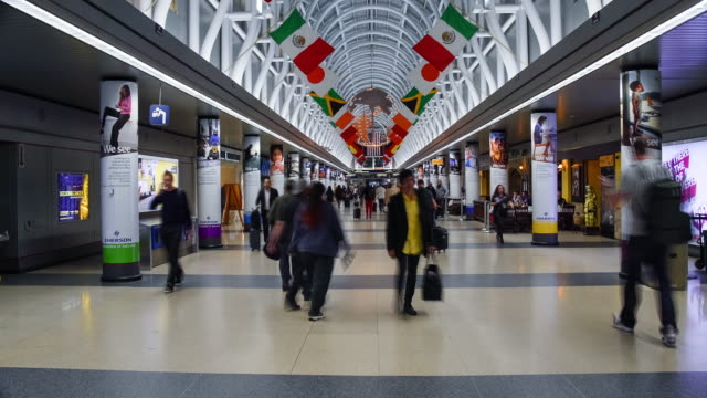 Travelers at Chicago, O'hare International Airport Time lapse of busy travelers at Chicago, O'hare International Airport. chicago stock videos & royalty-free footage