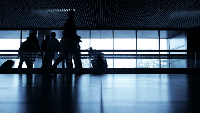 Travelers silhouettes at airport video