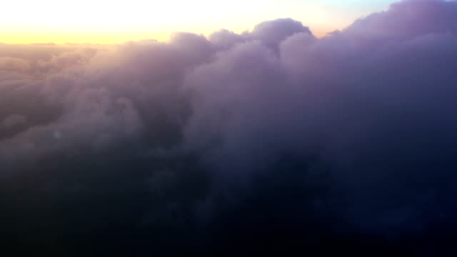 Traveling by air above sunset clouds. video