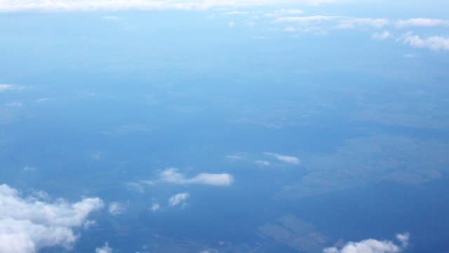 Traveling by air. View through an airplane window video