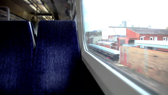 Traveling by train in Central London Traveling by train in Central London, looking out of the window. seat stock videos & royalty-free footage