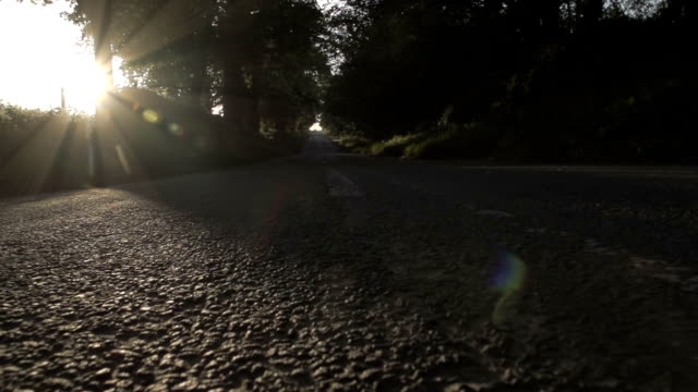 Traveling Down An English Road Filmed in the heartland of the British countryside as the sun was setting down a long open road. Shot in super slow motion at 240fps. alternative fuel vehicle videos stock videos & royalty-free footage