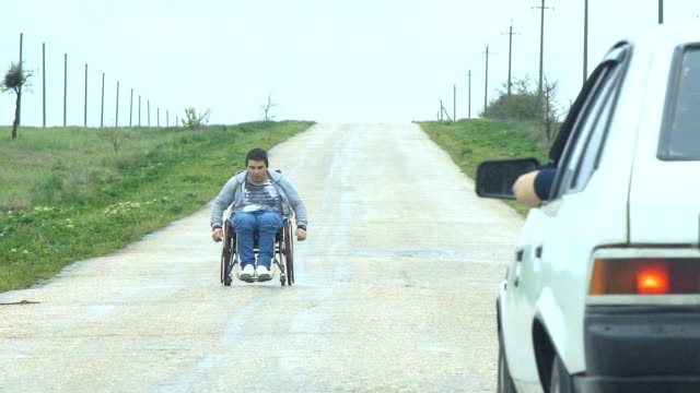 Traveling Man In Wheelchair Give Five video