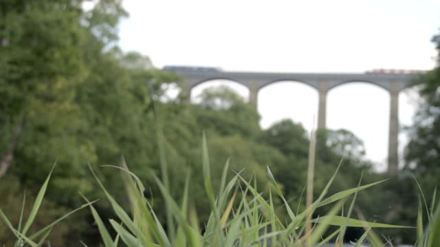 Traveling Over The Pontcysyllte Aqueduct A shot of a barge and pedestrians travelling over the world famous Pontcysyllte Aqueduct on the Llangollen Canal between Wales and England. aqueduct stock videos & royalty-free footage