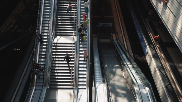 traveling people on stairs and escalator, berlin, germany - escalator video stock e b–roll
