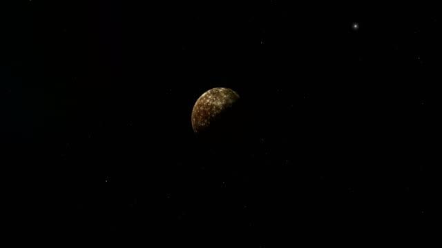 traveling towards callisto, jupiter's moon, in the outer space - io księżyc filmów i materiałów b-roll