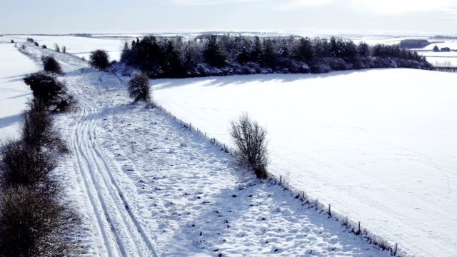 Travelling over winter farmland in snow video