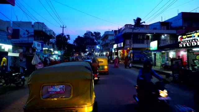 Travelling through traffic on road in an evening, Bangalore India