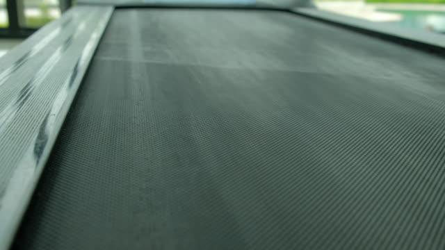 vídeos de stock e filmes b-roll de treadmill in the fitness room. - aparelho de musculação