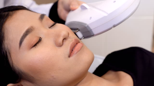 Treatment on Asian Woman as patient to make skin smooth bright video