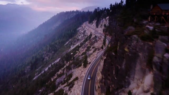 Tree Covered Valley in the Sierra Nevada With Highway 50 - Aerial Shot video