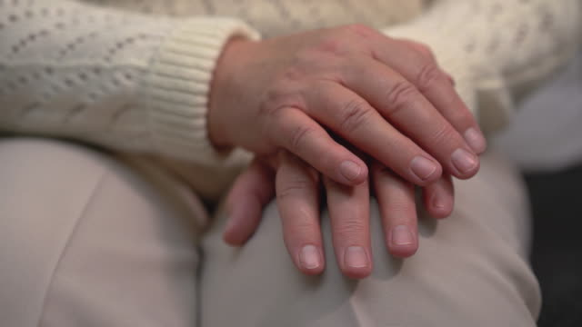 Trembling female hands, neurological illness, Parkinson's disease symptom Trembling female hands, neurological illness, Parkinson's disease symptom shivering stock videos & royalty-free footage