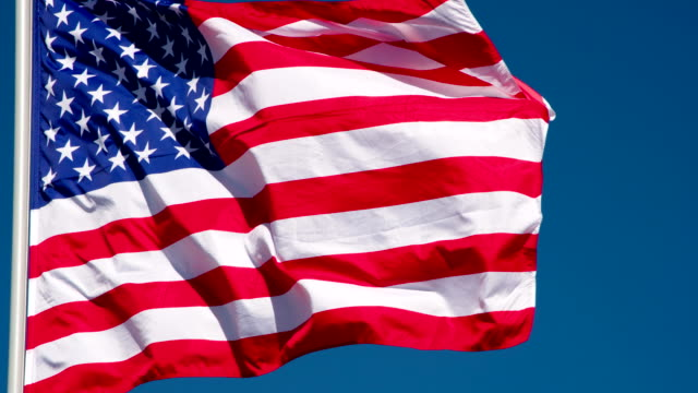 trembling usa flag against the sky - insygnia filmów i materiałów b-roll