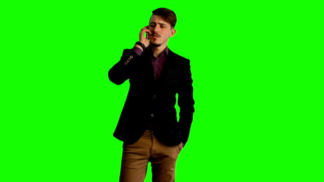 Trendy guy talk by Phone  green screen