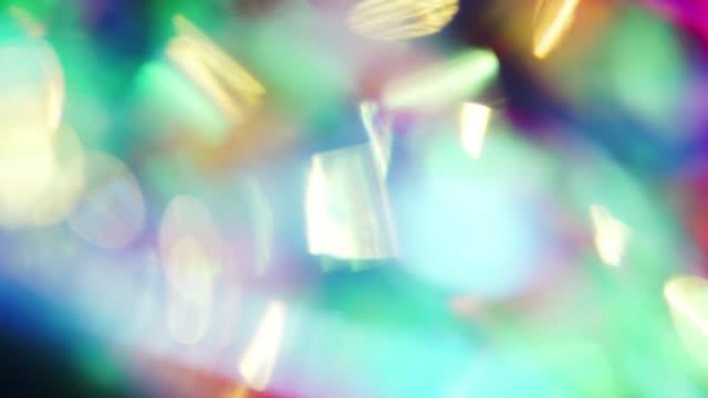 トレンディ虹色の抽象的な背景、光漏れトランジション、創造的なボケ。 - 玉虫色点の映像素材/bロール