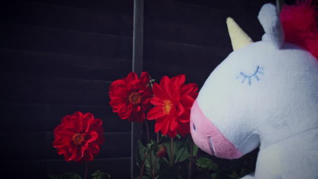 4K Trendy Unicorn Soft Toy Smelling Flower video