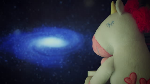 4K Trendy Unicorn Soft Toy Watching Galaxy video