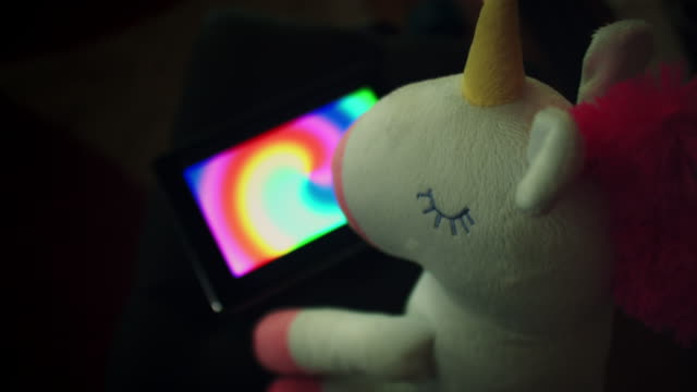 4K Trendy Unicorn Soft Toy Watching Rainbow on Phone video